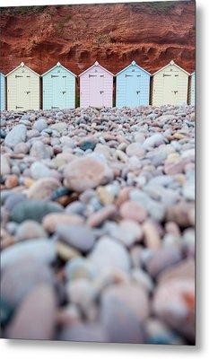 Beach Huts And Pebbles Metal Print