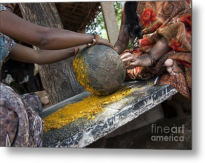 Crushing Turmeric Roots To Powder Metal Print by Tim Gainey