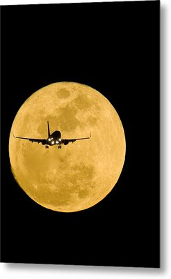 Aeroplane Silhouetted Against A Full Moon Metal Print by David Nunuk