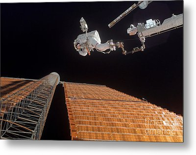 An Astronaut Anchored To A Foot Metal Print by Stocktrek Images