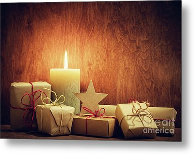 Chistmas Presents, Gifts With A Candle Glowing On Wooden Wall Background. Metal Print by Michal Bednarek