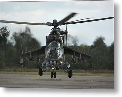 Metal Print featuring the photograph Mil Mi-24v Hind E by Tim Beach
