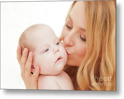Mother Holding And Kissing Her Newborn Baby. Motherhood Metal Print by Michal Bednarek