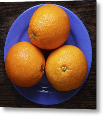 Naval Oranges On Blue Plate Metal Print