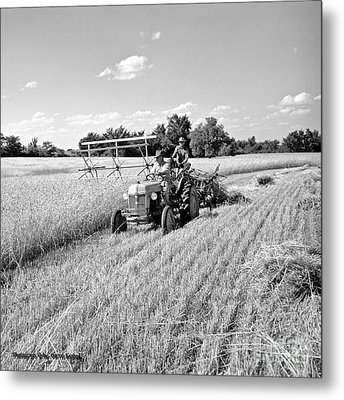 Old Combine Metal Print by Larry Keahey