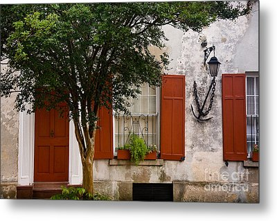 Red Shutters Metal Print by Susan Cole Kelly