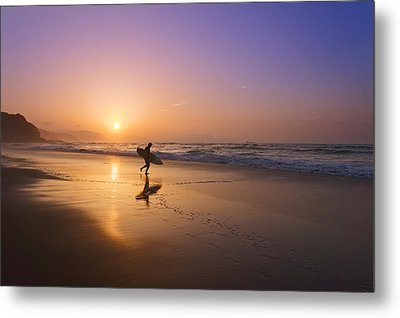 Surfer Entering Water At Sunset Metal Print by Mikel Martinez de Osaba