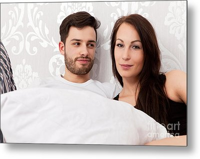Young Couple Snuggling In Bed Metal Print