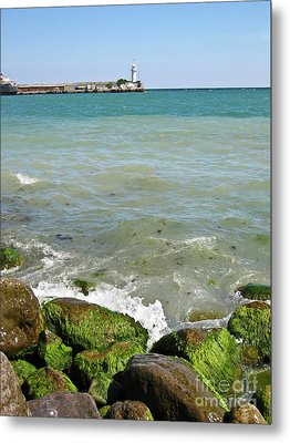 Lighthouse In Sea Metal Print