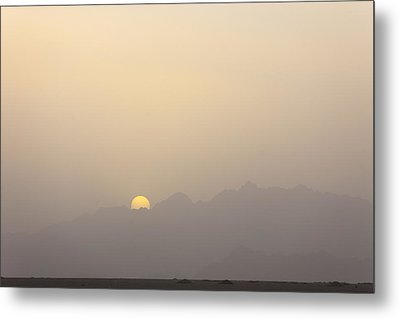 The Sun Sets Over The Mountains Metal Print by Taylor S. Kennedy