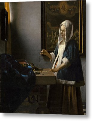 Woman Holding A Balance Metal Print by Johannes Vermeer