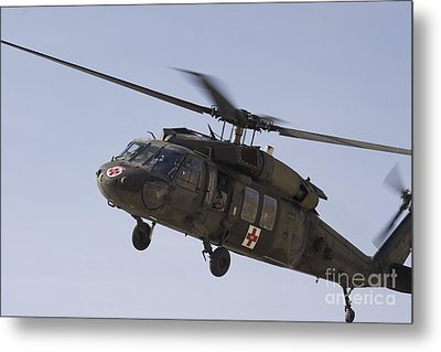 A Uh-60 Blackhawk Medivac Helicopter Metal Print by Terry Moore