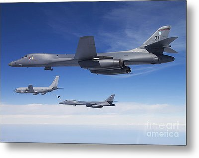 A B-1b Lancer Stands By As Another Metal Print by Stocktrek Images