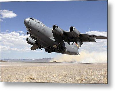 A C-17 Globemaster Departs Metal Print by Stocktrek Images