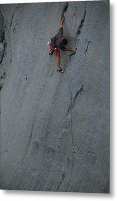 A Caucasian Man Rock Climbing Metal Print by Bobby Model