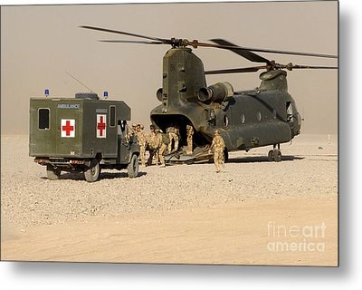 A Ch-47 Chinook Helicopter Drops Metal Print by Andrew Chittock