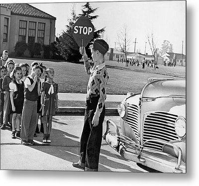 A Crossing Guard Holds Up Sign Metal Print