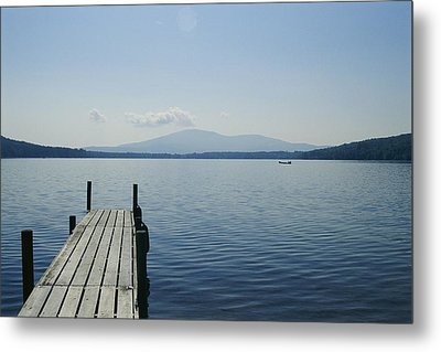 A Dock Juts Into The Metal Print by Stacy Gold