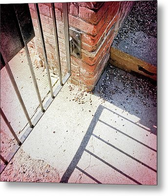 A Gate With Shadows Metal Print by Tom Gowanlock