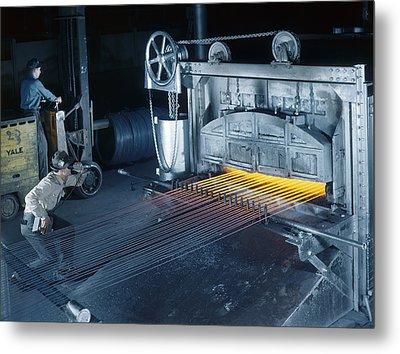 A Man Checks Temperatures Of Steel Rods Metal Print by Willard R. Culver