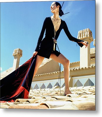 A Model On A Rooftop In A Dress By Paraphernalia Metal Print by Henry Clarke