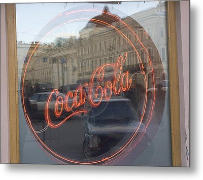 A Neon Coca Cola Sign Is Displayed Metal Print by Richard Nowitz