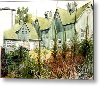 An Old Wooden Barn Painted Green With Silo In The Sun Metal Print by Greta Corens
