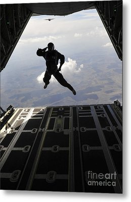 A Paratrooper Salutes As He Jumps Metal Print by Stocktrek Images