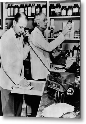 A Pharmacist Demonstrates The Use Of An Metal Print by Everett