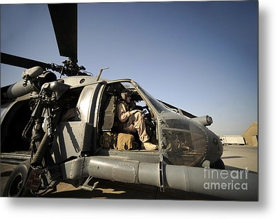 A Pilot Sits In The Cockpit Of A Hh-60g Metal Print by Stocktrek Images