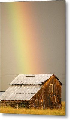 A Rainbow Arches From The Sky Onto Metal Print by Michael S. Lewis