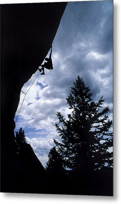 A Rock Climber Ascends A Steep Route Metal Print by Bill Hatcher
