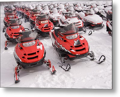 A Row Of Snowmobiles Sit Waiting Metal Print by Taylor S. Kennedy