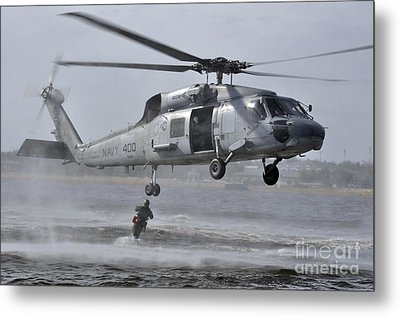 A Search And Rescue Swimmer Jumps Metal Print by Stocktrek Images