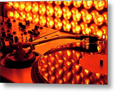 A Turntable And Sound Mixer Illuminated By Lighting Equipment Metal Print