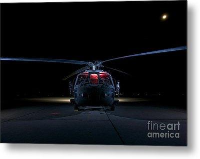 A Uh-60 Black Hawk Helicopter Lit Metal Print