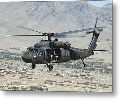 A Uh-60 Blackhawk Helicopter Metal Print by Stocktrek Images