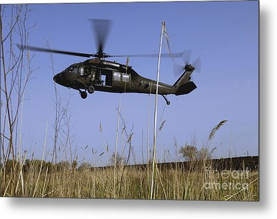 A U.s. Army Uh-60 Black Hawk Helicopter Metal Print by Stocktrek Images