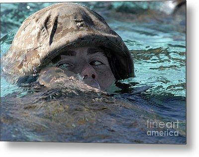 A U.s. Marine Swims Across A Training Metal Print by Stocktrek Images