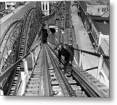 A Workman Greases Up The Tracks Metal Print by Everett