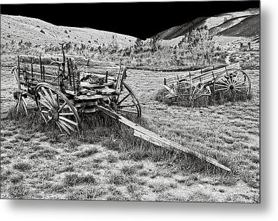 Abandoned Wagons Of Bannack Montana Ghost Town Metal Print by Daniel Hagerman