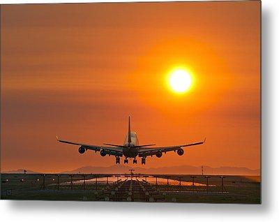 Aeroplane Landing At Sunset Metal Print by David Nunuk