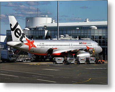 Airbus A320-232 Metal Print by Tim Beach