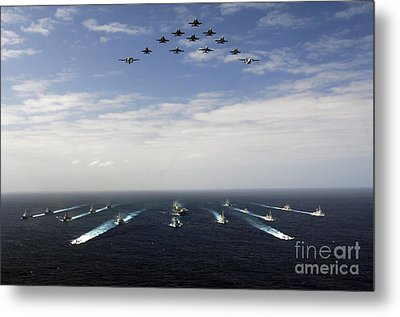 Aircraft Fly Over A Group Of U.s Metal Print by Stocktrek Images