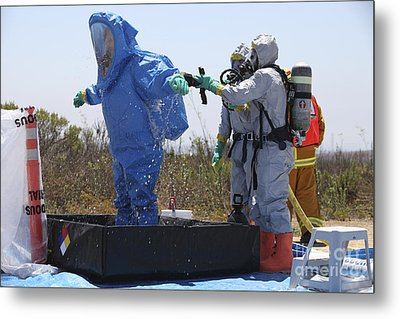 An Airman Stands In A Tub Of Cleaning Metal Print by Stocktrek Images