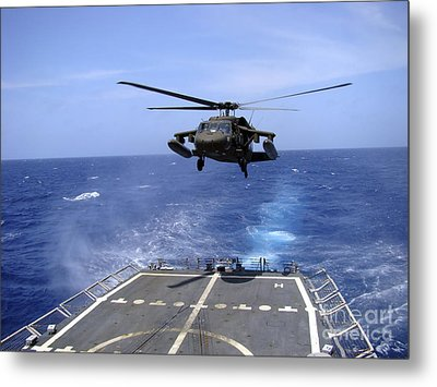 An Army Uh-60 Black Hawk Helicopter Metal Print by Stocktrek Images