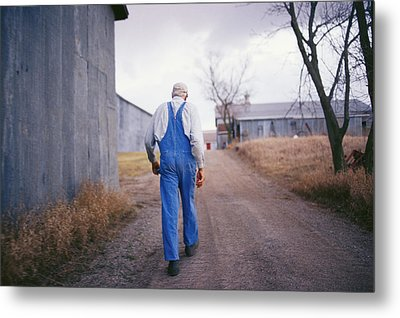 An Elderly Farmer In Overalls Walks Metal Print by Joel Sartore