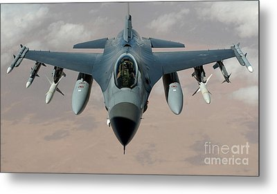 An F-16 Fighting Falcon Flies A Mission Metal Print by Stocktrek Images