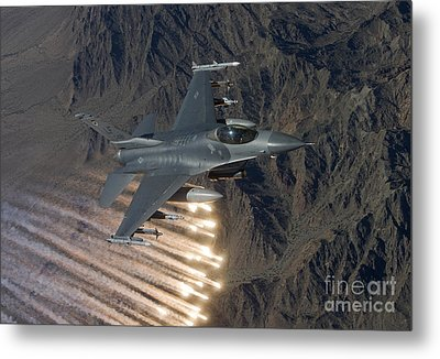 An F-16 Fighting Falcon Releases Flares Metal Print by HIGH-G Productions