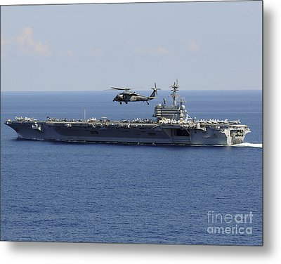 An Mh-60s Seahawk Helicopter Flies Metal Print by Stocktrek Images